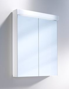 Lowline W60cm mirror cabinet to go above sink.  Comes in different sizes dependent on sink size.  Or alternatively can have a flat mirror and wall lights.