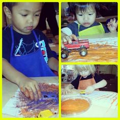 Transportation Theme: Painting with cars & trucks. These are boys are in heaven!