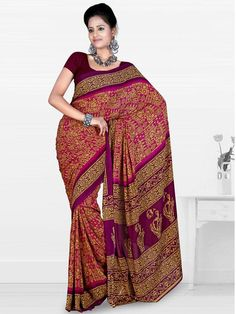 Get a stunning look for any casual occasion in this saree made of faux georgette material. The saree is purple in color and has abstract print and floral print all over it. The contrasting border and pallu gives it a beautiful look. It is accompanied by a contrasting blouse which highlights it. (Slight variation in color is possible)