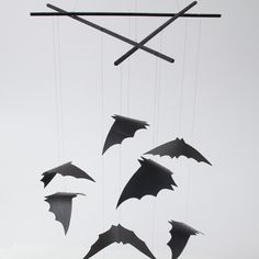 Create your own bat mobile! All you need are a wooden dowel, black paint and shelf liner.