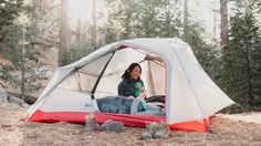 Campers relax in the REI Co-op Quarter Dome 2 tent