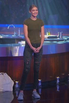 Gigi Hadid wearing  Adidas Women's Yeezy Boost 350 Moonrock, Fox Merchandise Masterchef Apron Official Merchandise, A Gold E Chloe Low Rise Slim