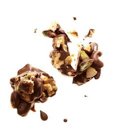 Mix together ¼ cup unsalted roasted nuts and 1 ounce melted dark chocolate (70 to 80 percent cocoa). Drop onto wax paper; refrigerate until set.