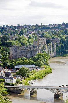 Chepstow Castle in Wales, on top of cliffs overlooking the River Wye, is the oldest surviving post-Roman stone fortification in Britain. Its construction was begun under the instruction of the Norman Lord William fitzOsbern, soon made Earl of Hereford, from 1067, and it was the southernmost of a chain of castles built along the English-Welsh border in the Welsh Marches.