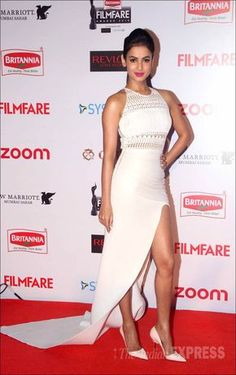 Sonal Chauhan in a white dress with high slit at #FilmfareAwards Pre-Party. #Bollywood #Fashion #Style #Beauty #Hot #Sexy