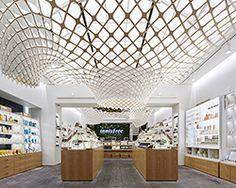 SOFTlab weaves undulating greenhouse lattice through innisfree shop in seoul