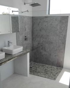 Fresh bathroom interior created with Cemcrete SatinCrete Dolphin Grey on the shower wall and Colour Hardener White floors. #cemcrete #satincrete #colourhardener #bathroom #bathroomdesign #cementfinish #decorativewall #featurewall #wallfinish #cement ...