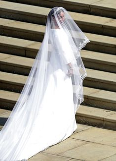 The great dress reveal of 2018 is finally here.                                  After months of impassioned speculation about what Meghan Markle would wear for her royal wedding to Prince Harry, the bride walked down the aisle at Windsor Castle's St. George's Chapel in what's already become an iconic wedding