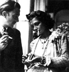 Salvador Dali and Coco Chanel hanging out having a smoke.