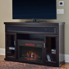 the tenor features a built in bluetooth sound bar and a classicflame electric fireplace - Tv Stands With Built In Fireplaces
