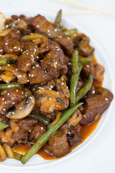 ... mushrooms, onions and green beans in a savory sesame sweet soy sauce
