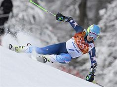 DAY 13:  Ted Ligety of the USA wins the gold medal during the Alpine Skiing Men's Giant Slalom