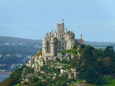 St Michael's Mount, a tidal island off the Mount's Bay coast of Cornwall, England, proudly flies the British flag Cornwall Coast, West Cornwall, Devon And Cornwall, Cornwall England, Penzance Cornwall, Palaces, Monuments, Mt St Michel, St Michael's Mount