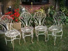Vintage Set of 4 White Metal Shabby Chic Garden Chairs With Folding Backs.