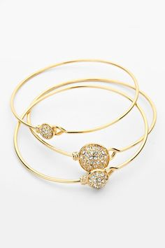 3 Bracelets in 1 Set. Pave Crystal Circlets layered in Gold. Wear One or All.