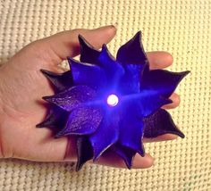 Oh my goodness I am so in love with these and I think I want one in my bouquet, even if FH is the magic player, not me =P How to make your own light-up, leather lotus flowers | Offbeat Bride