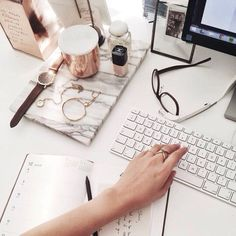 Black&white+grey workspace decor ideas. Rose gold candle and marble stand. IMac and Chanel nude nail polish.
