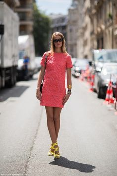 Carlotta Oddi in a coral dress and yellow sandals.