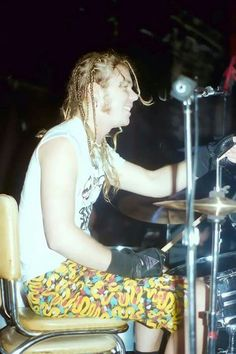 James Hetfield (Metallica) on the drums with braided hair this is all so.. not James lol