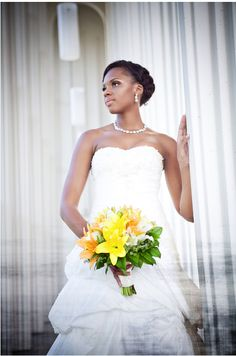 We love weddings with a pop of yellow. This bride is so pretty! The wedding dress was designed by Maggie Sottero.
