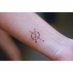 Minimalist compass tattoo on the wrist. Tattoo artist: Seoeon