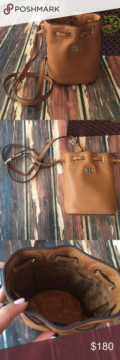 NWT Tory BURCH Brody Mini Bucket Bag Brand new with tags authentic Tory BURCH Brody Mini Bucket Bag Satchel. Gorgeous brown pebbled leather with gold hardware. Drawstring top, adjustable shoulder strap.     ️ NO Trades‼️‼️         offers appreciated thru the offer button.              〽️ercari always has listing at a lower price ! Tory Burch Bags Satchels