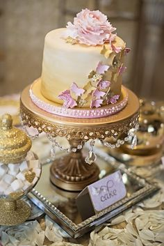 Look at this cake! Butterfly Kisses Pink + Gold Valentine's Day Tea Party via Kara's Party Ideas KarasPartyIdeas.com Tutorials, cake, invitation, banners, desserts and more! #butterflykisses #butterflyteaparty #teapartyideas #valentinesdayteaparty #pinkandgold #goldandpink #butterflykissesparty #karaspartyideas #partystyling #valentinesdaypartyideas #pinkandgoldvalentinesdayparty #goldteaparty #butterflyparty (33)