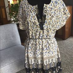 Aggie tunic Adorable tunic that can be worn with leggings, jeans, or by itself...So versatile!!  Beautiful pattern!  Worn once, no flaws, and from a smoke free home. But from a local upscale boutique. Tops Tunics