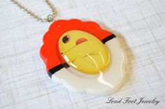 Pikachu in a Pokeball Resin Pendant by LeadFootJewelry on Etsy