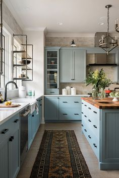 Pictures of the HGTV Smart Home 2018 Kitchen Blue kitchen cabinets + vintage rug + butcher block island countertop + farmhouse sink + industrial open shelving + industrial pendent lights Blue Kitchen Cabinets, Kitchen Appliances, Teal Cabinets, Kitchen Sink, Kitchen Rug, Island Kitchen, Apartment Kitchen, Kitchen Countertops, Island Sinks