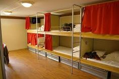 use curtains for each bunk to provide some privacy and keep the overhead light from waking you up at 3am if someone inconsiderate stumbles in late