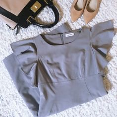 """Calvin Klein Dress (Petite) Petite fit. Grey color is called """"tin tin"""". Chest measures 15 inches across.Length measures 35 inches from shoulder to bottom hem.Shell: 63% Polyester/33% Rayon/4% Spandex. Lining is 100% Polyester. Dry clean only. There is a small area of discoloration near the bottom on one of the side seams (see last photo).Barely noticeable&could probably be removed by a dry cleaner.Looks like makeup from being tried on at the store.Purchased at Belk.  Reasonable offers…"""