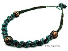 Teal Russian Spiral necklace. Russian spiral beadweaving - seed beads, pearls, glass focal beads. Image copyright © Rose Rushbrooke.