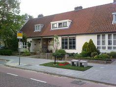 Houten huizen in de Doornakkers.