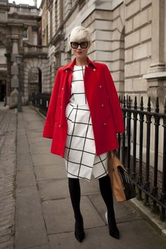 The 25 Best Street Style Snaps From London Fashion Week: Model Linda Tol looking sharp in black and white and red all over.     Photo: Getty