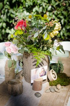 Twine wrapped bottles, mason jars, fresh moss, river rock, wood pieces, hand carved wood vases, lace and burlap