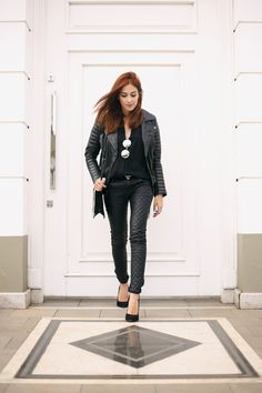 All black outfit wearing Viparo perfect leather jacket, leather pants and high heels. Just a few accessories with mirrored sunglasses and bag.
