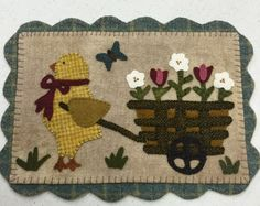 """Spring Has Sprung"" from the Spring 2015 issue of Primitive Quilts and Projects magazine"
