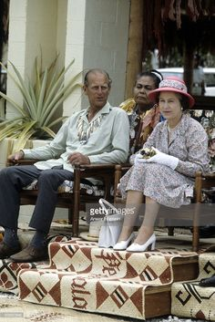 Queen Elizabeth ll, holding her gold Rollei camera, and Prince Philip, Duke of Edinburgh, wearing a traditional shell necklace watch traditional dancers on October 1982 in Tuvalu. Hm The Queen, Royal Queen, Her Majesty The Queen, Save The Queen, Elizabeth Philip, Queen Elizabeth Ii, Santa Lucia, Queen And Prince Phillip, Prinz Philip