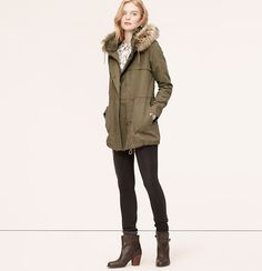 """We love the fresh-off-the-slopes appeal of this plush-trimmed anorak, done in a luxe cotton linen blend. Removable zip hood. Funnel collar. Long sleeves. Drawstring ties at collar and hem. Front storm flaps. Zip and snap front. Snap pockets and cuffs. Interior drawstring waist and hem. Lined. 29 1/2"""" long."""