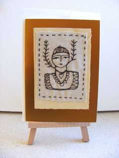 original embroidered card on gold