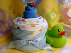 Items similar to Children's Hooded Bath Towel Gift with 2 Baby Washcloths and 1 Fish Bath Sponge.Baby Shower Gift for Boy.Toddler Birthday Gift :) on Etsy Baby Shower Cakes, Baby Shower Parties, Baby Shower Gifts, Baby Gifts, Baby Showers, Duck Diapers, Princess Diaper Cakes, Diy Diaper Cake, Towel Cakes