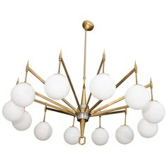 12-Arm Brass Chandelier with White Opaque Globes | From a unique collection of antique and modern chandeliers and pendants  at https://www.1stdibs.com/furniture/lighting/chandeliers-pendant-lights/