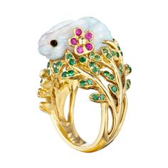 """Mimi So Carved Opal & Gem-Set Bunny Ring """"Fernita"""" carved white opal bunny ring in yellow gold, perched atop a tsavorite garnet-encrusted foliate mount, with two pink sapphire floral accents. Handcrafted in New York City. Designed by Mimi So."""