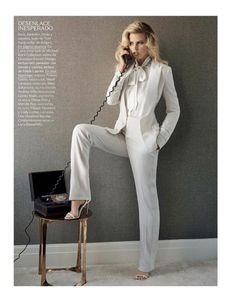 Wearing white, Lara Stone poses in Tom Ford jacket, blouse, pants and suits #womenpantssuits