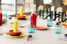 Bright colors bring a tropical feel to this dining table in Puerto Vallarta #CousinsOnCall