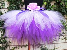 This listing is for a 15 3 tiered sewn pixie tutu. This beautiful tutu is made with 3 purple colors to create a perfectly purplicious tutu!    This tutu is great for many occasions including holidays, birthday parties, recitals, spring portraits, dress up, pageants, photo props, and so much more! Look for coordinating accessories in my shop!    Technique and Materials:  All of my tutus are created using a technique that allows for maximum stretch and durability! My tutus are machine sewn on…