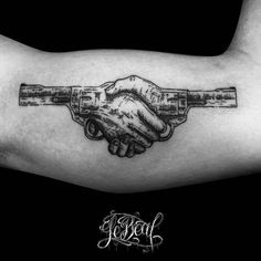 Surrealist handshake duel tattoo on the left inner arm.