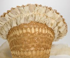 Openwork Bonnet (detail): ca. 1850's, braided straw, ruched chiffon ruffles ending in long ties.