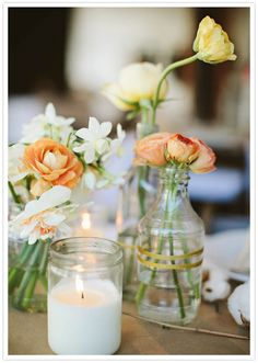 I like the mix of different glass jars and vases with long stem flowers. Plus a few white candles. Plus we could paint the glass with a color u might want to work it. Like a red, white or black.